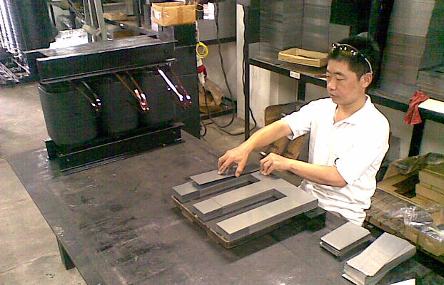 Man with Transformer Iron Core at Poly